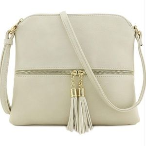 Zipper tassel crossbody bag